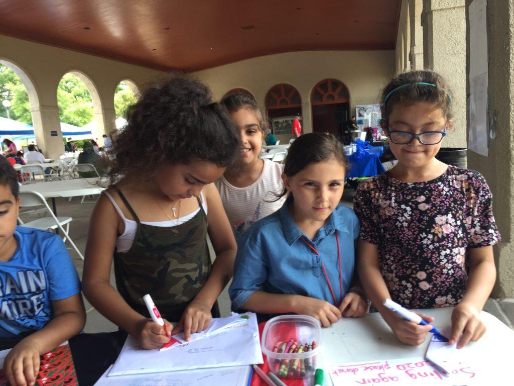 Girls drawing boats